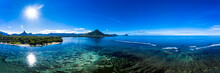 Mauritius, Black River, Flic-en-Flac, Aerial Panorama Of Blue Coastline Of Indian Ocean With Tourelle Du Tamarin Mountain In Distant Background