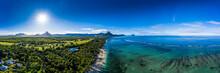 Mauritius, Black River, Flic-en-Flac, Aerial Panorama Of Sun Shining Over Palm Trees Along Coastal Beach In Summer