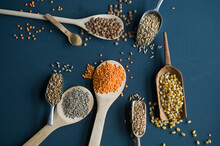 Red Lentils, Brown Lentils, Amarant, Wheat, Spelt Wheat And Corn On Spoons