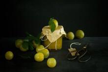 Studio Shot Of Greengages And Jar Of Homemade Plum Jam