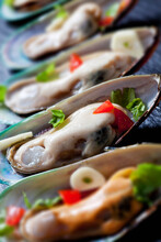 Green Mussels With Tomatoes, Capsicum And Garlic, On Black Slate Slab