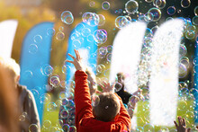 Children's Street Party With Soap Bubbles