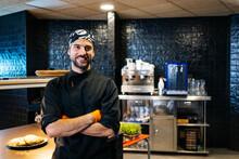 Portrait Of Smiling Chef In Restaurant Kitchen