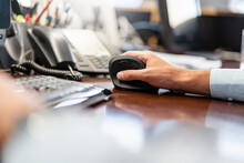 Close-up Of Businessman Using Ergonomic Mouse In Office