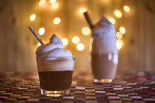 Coffee With Cream With Bokeh Lights On The Background