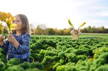 Girl And Boy In A Kali Field, Leaves As Rabbit Ears
