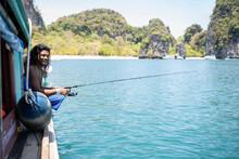 Young Native Man Fishing On A Boat Trip, Ko Yao Yai, Thailand