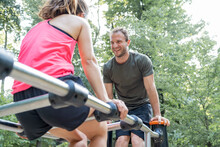 Man And Woman Exercising On A Fitness Trail