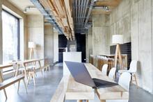 Laptop On Wooden Boards In Modern Office