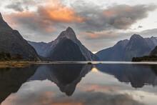 New Zealand, Mitre Peak Reflecting On Shiny Surface Of Milford Sound At Dusk