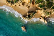 Portugal, Algarve, Alvor, Drone View Of Sandstone Cliffs And Beach At Praia Dos Tres Irmaos