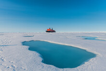 Aerial View Of Melting Ice On North Pole With Ice-breaker 50 Years Of Victory In Background