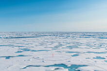 Aerial View Of Round Marker Set Up On Melting Ice At North Pole