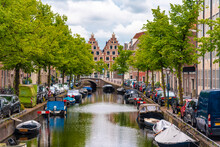 Netherlands, North Holland, Haarlem, Boats Moored Along City Canal