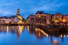 Netherlands, South Holland, Leiden, Buildings Surrounding Nieuwe Rjin Canal At Dusk