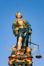Switzerland, Canton Of Bern, Bern, Statue Of Lady Justice Standing On Top Of Gerechtigkeitsbrunnen Fountain