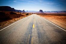 USA, Arizona, Empty Highway Across Monument Valley