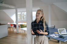 Young Businesswoman Talking In Office