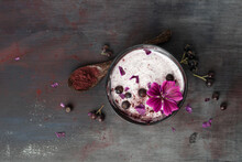 Bowl Of Natural Yoghurt With Aronia Powder And Hollyhock Flower