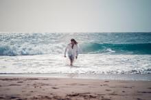 Man Wading At Seashore