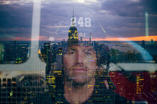 Portrait Of Confident Firefighter With The Reflected Skyline Of New York City, United States