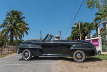 Woman In A Vintage Convertible Car On Cuba