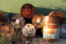 Rusty Barrels In A Scrapyard