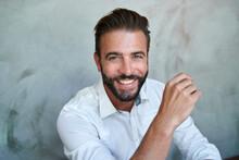 Portrait Of Happy Businessman Wearing White Shirt