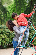 Mother And Son Playing On Playground In A Park, Climbing In A Jungle Gym