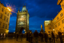 Czechia, Prague, Old Town Bridge Tower At Blue Hour, Tourists In The Foreground