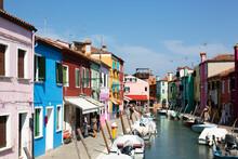 Italy, Veneto, Venice, Colorful Houses Along Canal On Burano Island