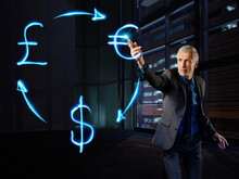 Businessman Pianing Currency Curculation With Light