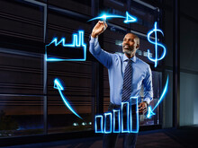 Businessman Painting Economic Circulation With Light
