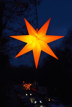 Star Shaped Christmas Decoration Glowing Outdoors At Night