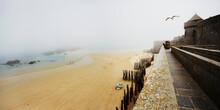France, Bretagne, Saint-Malo, Beach And Fortress In Fog