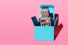 Studio Shot Of Vintage Robot Toy In Turquoise Gift Box