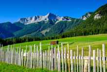 Austria, Tyrol, Steinberg Am Rofan, Simple Fence Surrounding Countryside Pasture With Guffert Mountain In Background