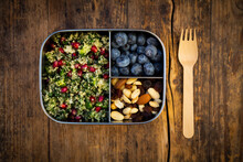 Lunchbox With Bulgur Herbs Salad With Pomegranate Seeds, Taboule, Blueberries And Trail MIx