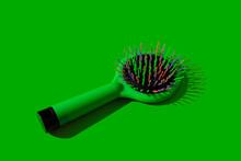 Studio Shot Of Green Hairbrush