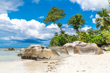 Seychelles, Mahe, Granite Rocks And Palm Trees At BeauÔøΩVallonÔøΩBeach In Summer
