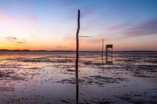 United Kingdom, England, Northumberland, Posts Marking The Pilgrims' Way Crossing To Lindisfarne With Emergency Refuge, Sunrise