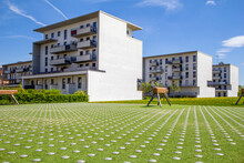 Germany, Bavaria, Munich, Playground With Gymnastics Vaults In Front Of Residential Buildings In Theresienpark