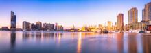 Modern Buildings In Front Of Yarra River At Melbourne Docklands Against Sky At Sunset, Victoria, Australia