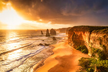 Scenic View Of Sea Against Cloudy Sky At Twelve Apostles Marine National Park During Sunset, Victoria, Australia