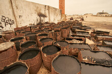 Old Oil Drums At The Abandoned Village Of Ilha Dos Tigres, Angola