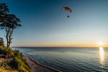 Paragliding Over Sea In Poland Against Clear Sky