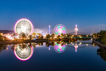 Germany, Stuttgart, Bad Cannstatt, Fairground Rides At Cannstatter Wasen At Iver Neckar