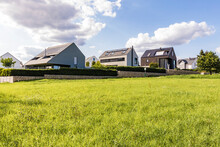 Houses With Solar Panels On Roof By Field Against Sky, Baden-WÔøΩrttemberg, Germany