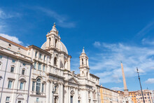 Italy, Rome, Low Angle View Of Sant Agnese In Agone Church With Agonalis Obelisk In Background