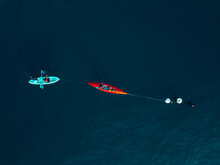 Indonesia, Bali, Sanur, Aerial View Of People Fishing At Blue Sea